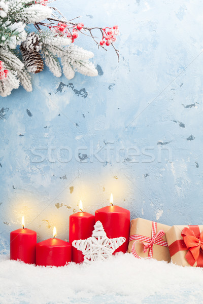 Christmas candles, gifts and fir tree Stock photo © karandaev