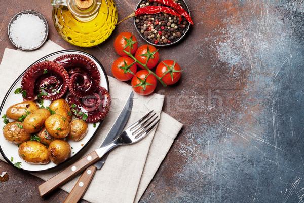 Alla griglia polpo piccolo patate erbe spezie Foto d'archivio © karandaev