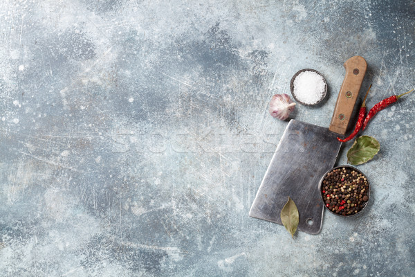 Butcher. Vintage meat knife over stone table and spices Stock photo © karandaev