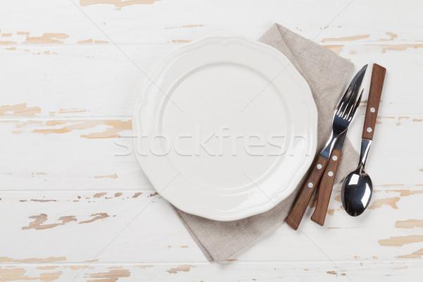 Empty plate with silverware Stock photo © karandaev
