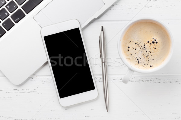 Stock photo: Smartphone on office workplace table