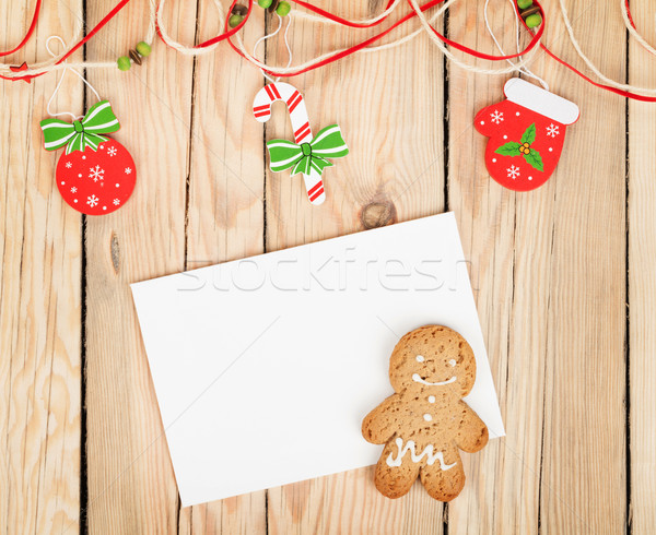Christmas decor, gingerbread cookie and card for copy space Stock photo © karandaev