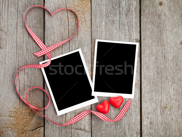 Two photo frames and small red candy heart Stock photo © karandaev