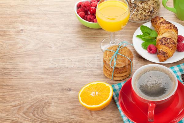 Gezonde ontbijt müsli bessen sinaasappelsap koffie Stockfoto © karandaev