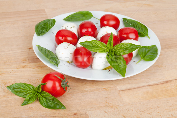 Caprese salatası plaka ahşap masa gıda yaprak arka plan Stok fotoğraf © karandaev