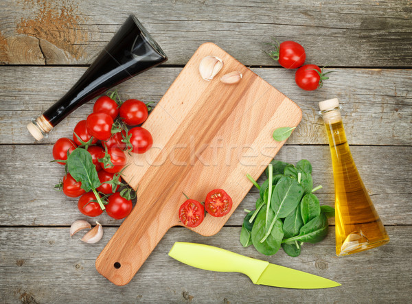 Cherry tomatoes with salad and condiments Stock photo © karandaev