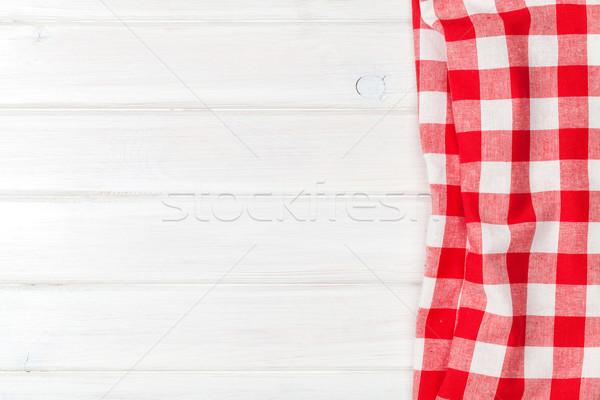 Rosso asciugamano legno tavolo da cucina copia spazio Foto d'archivio © karandaev