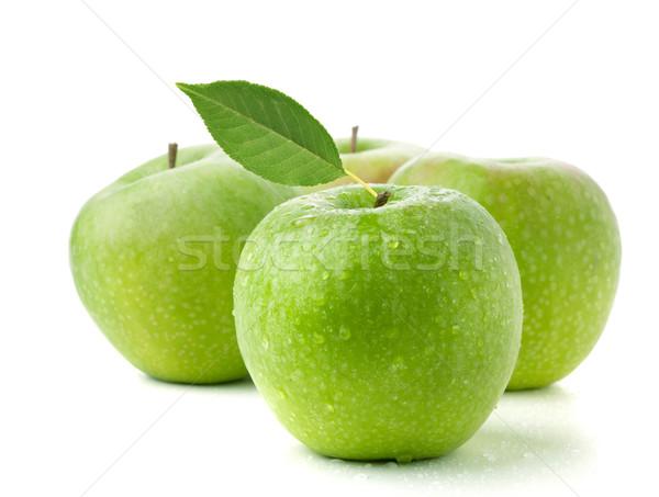 Four ripe green apples Stock photo © karandaev