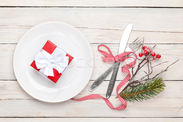 Stock photo: Gift box on plate, silverware and christmas decor
