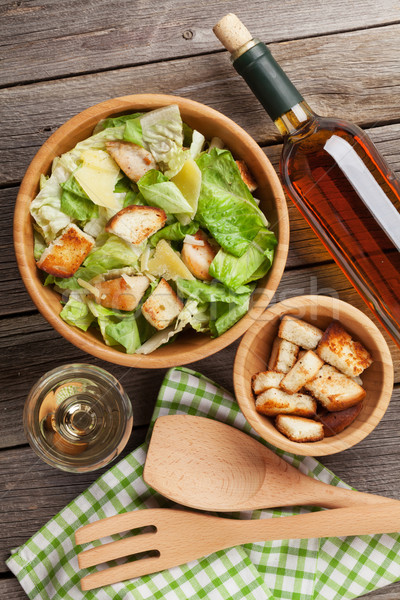 Fresh healthy caesar salad and white wine Stock photo © karandaev