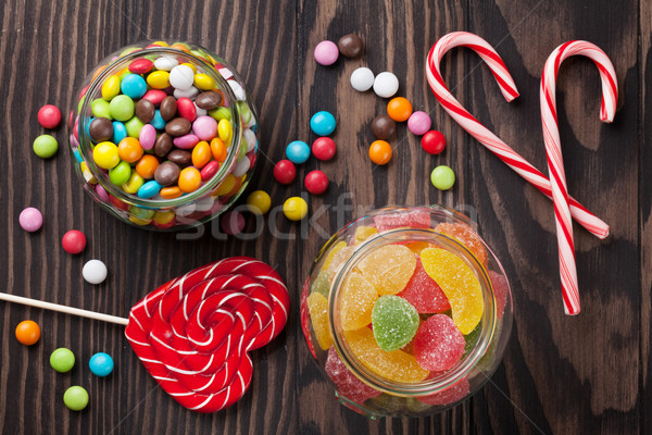 Colorful candies on wooden table Stock photo © karandaev