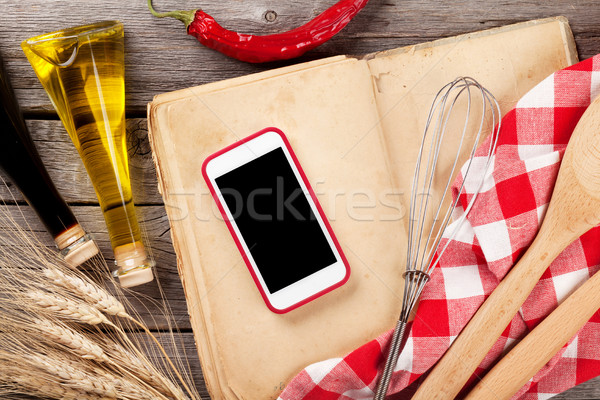 Kitchen table with ingredients, utensils and phone Stock photo © karandaev