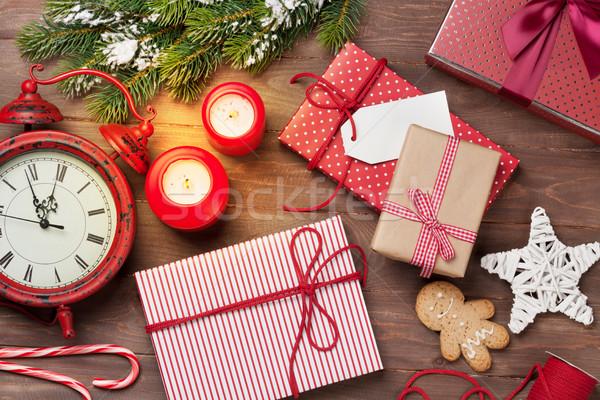 Christmas gift boxes, alarm clock and fir tree Stock photo © karandaev