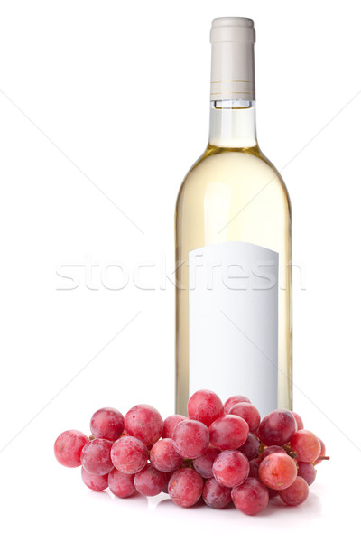 White wine in bottle and red grapes Stock photo © karandaev