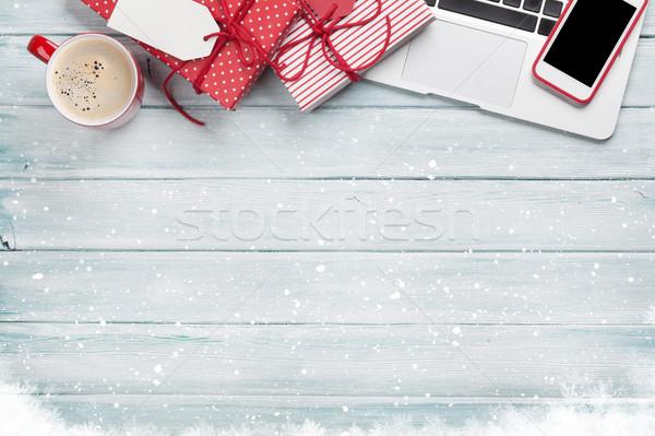 Christmas gift boxes, pc and coffee cup on wood Stock photo © karandaev