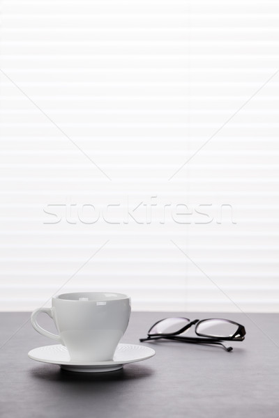 Office workplace with coffee and glasses Stock photo © karandaev