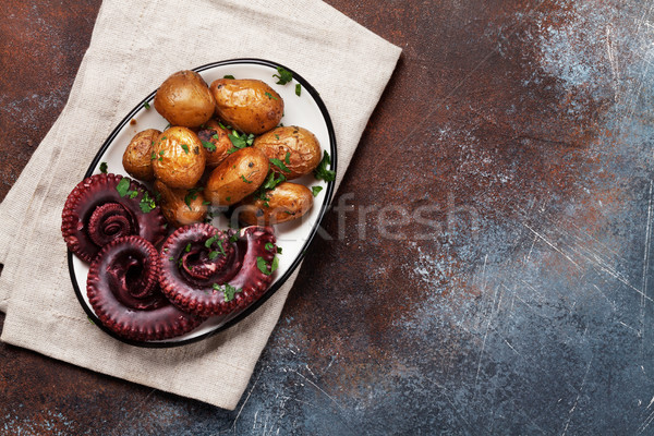 Grilled octopus with small potatoes Stock photo © karandaev