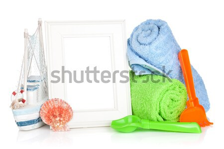 Photo frame with bath towel and boy dummy Stock photo © karandaev