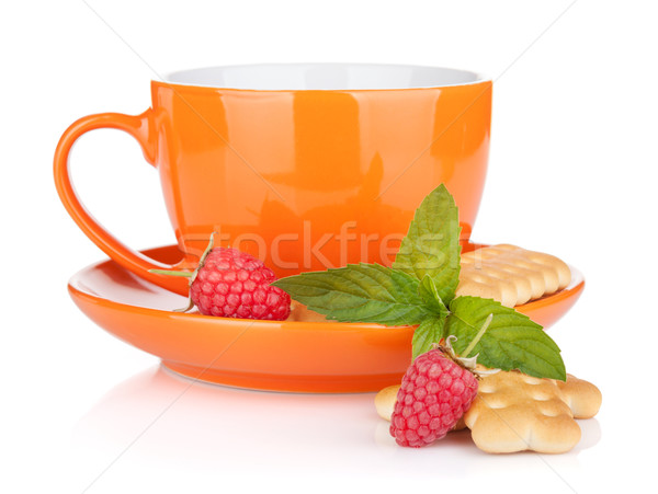 Stock photo: Cup of drink with crackers, mint and berries