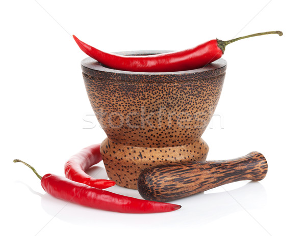 Mortar and pestle with red hot chili pepper Stock photo © karandaev