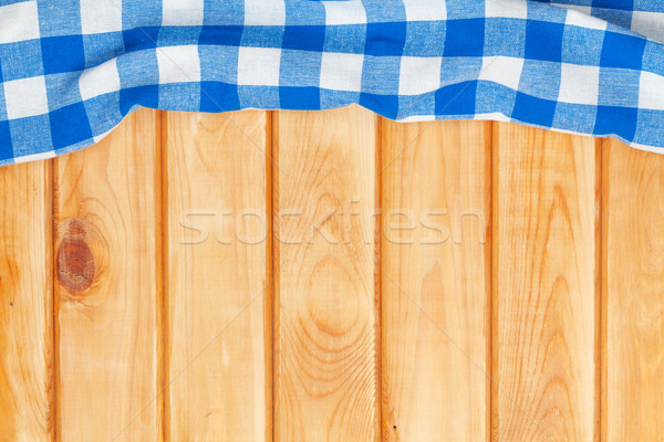 Blue towel over wooden kitchen table Stock photo © karandaev