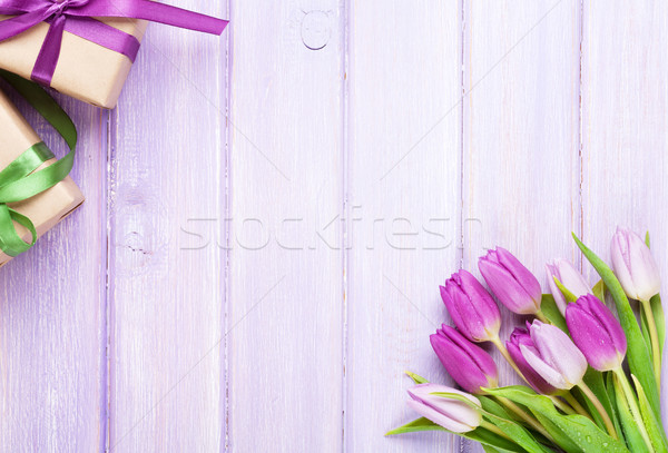 Purple tulips and gift boxes over wooden table Stock photo © karandaev