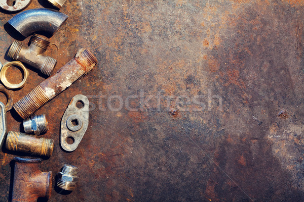 Workbench metal table with old water supply parts Stock photo © karandaev