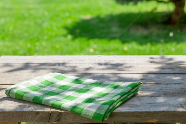 Empty wooden garden table with tablecloth Stock photo © karandaev