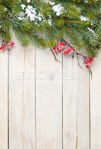 Christmas wooden background with fir tree and holly berry Stock photo © karandaev