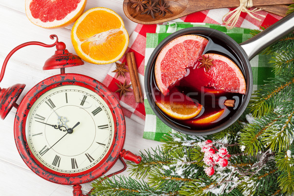 Christmas mulled wine and alarm clock on wooden table Stock photo © karandaev