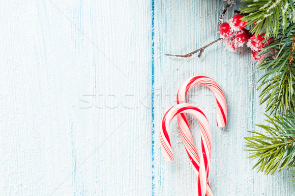 Candy cane and christmas tree on wooden table Stock photo © karandaev