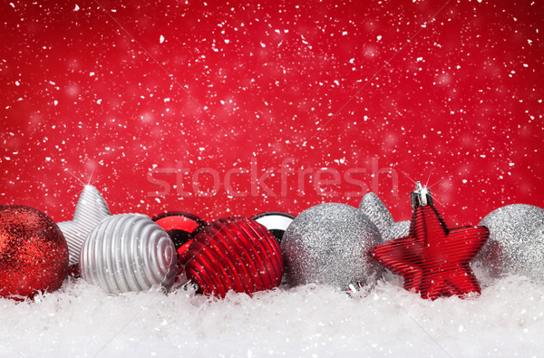 Christmas red background with baubles in snow Stock photo © karandaev
