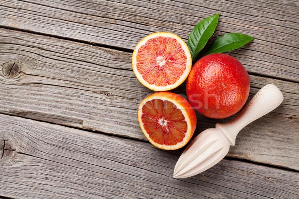 Fresh red oranges and juicer Stock photo © karandaev