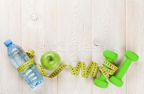 Egészséges étel fitnessz súlyzó vizes flakon alma fa asztal Stock fotó © karandaev