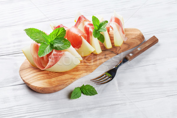 Fresh melon with prosciutto and mint Stock photo © karandaev