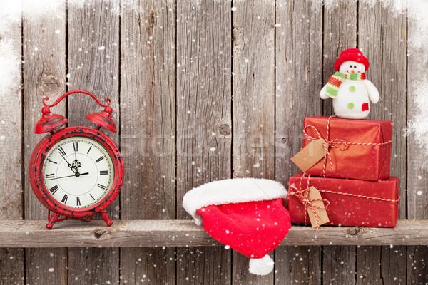 Christmas gift boxes, alarm clock and snowman Stock photo © karandaev