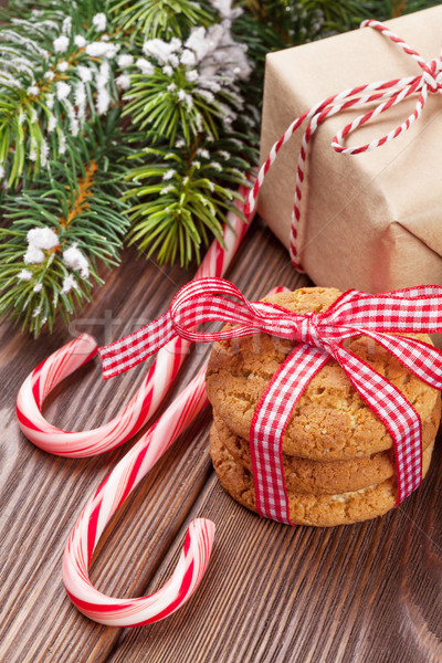 Christmas gift, candy cane and tree branch Stock photo © karandaev