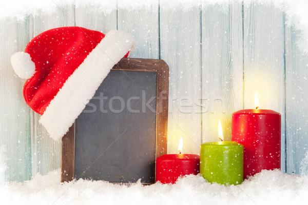 Christmas candles and chalkboard Stock photo © karandaev