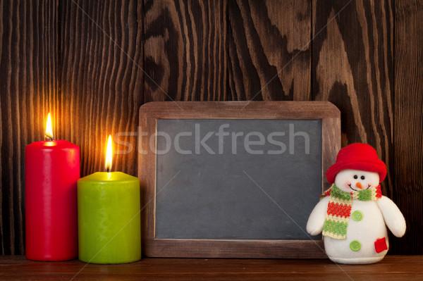 Christmas candles, snowman and chalkboard Stock photo © karandaev