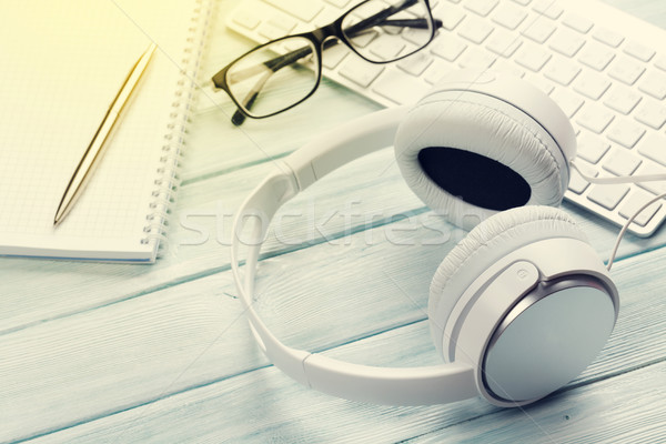 Headphones, pc keyboard and notepad Stock photo © karandaev