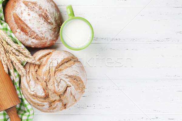 Stock photo: Homemade crusty bread and milk