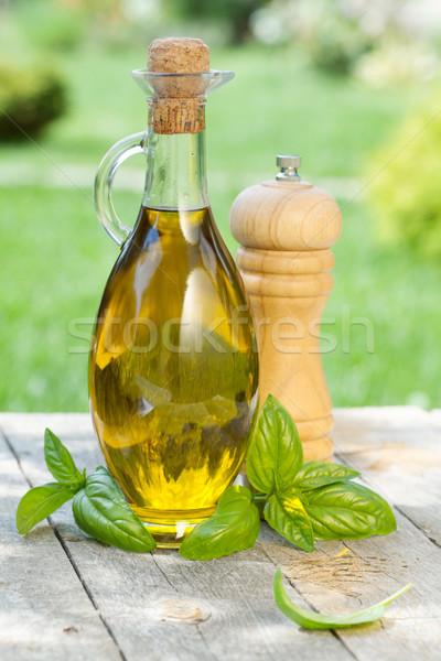 Zeytinyağı şişe biber shaker fesleğen ahşap masa Stok fotoğraf © karandaev