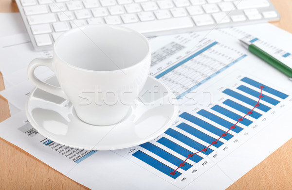 Empty cup on contemporary workplace Stock photo © karandaev