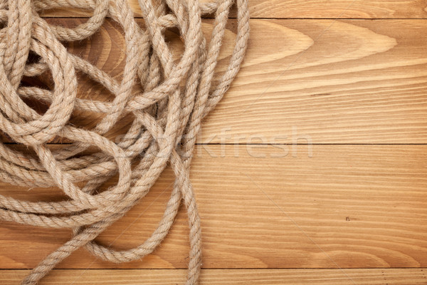 Ship rope on old wooden texture background Stock photo © karandaev