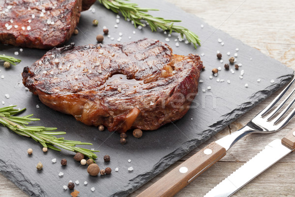 Beef steaks with rosemary and spices Stock photo © karandaev