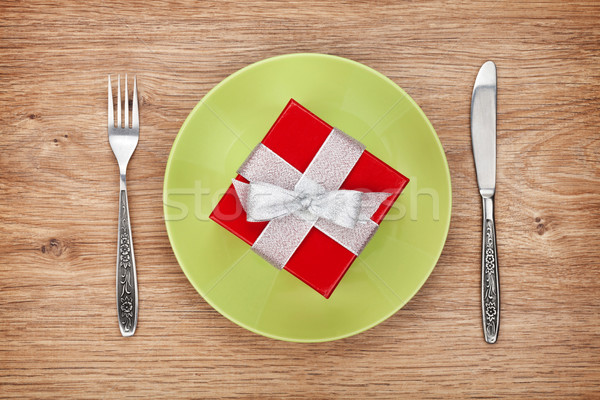 Gift box on plate and silverware Stock photo © karandaev