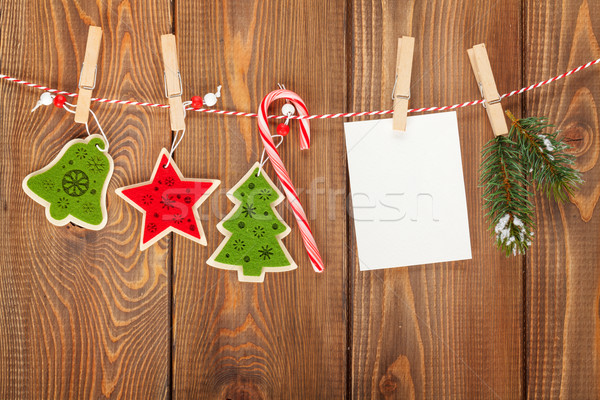 Snow fir tree, photo frame and christmas decor on rope Stock photo © karandaev
