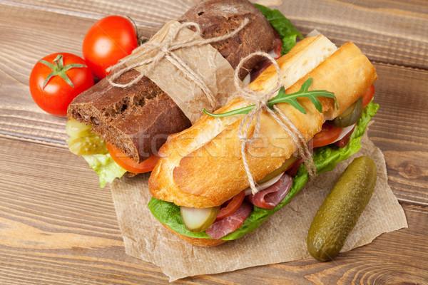 Two sandwiches with salad, ham, cheese  Stock photo © karandaev