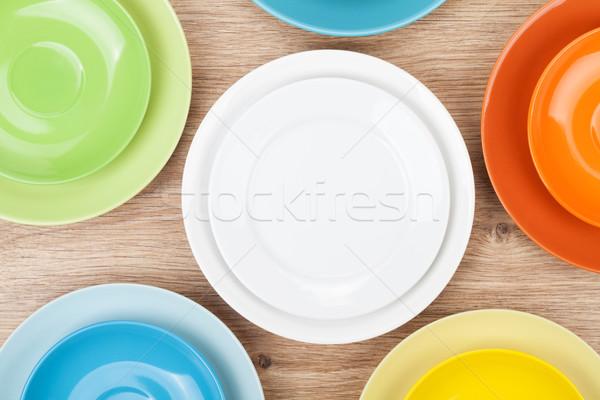 Colorido placas mesa de madeira comida projeto Foto stock © karandaev