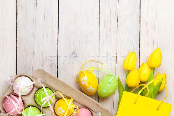 Pâques coloré oeufs jaune tulipes blanche Photo stock © karandaev